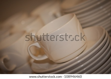 photo of cups and saucers on a bar