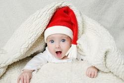 photo of cute baby in Santa hat