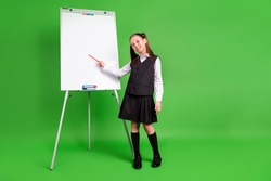 Photo of cute funny schoolgirl dressed white black uniform smiling having lesson empty space isolated green color background