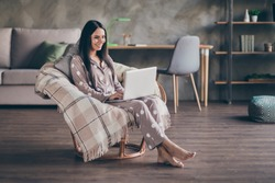 Photo of cute optimistic girl sit type laptop wear pijama spectacles at home