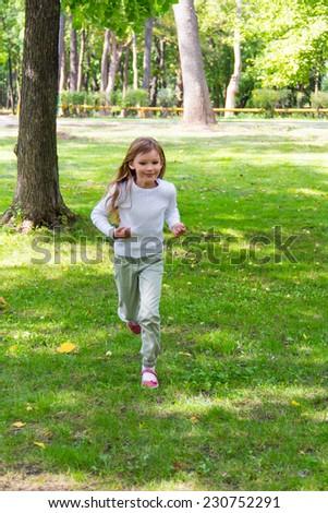 Photo of cute running girl in summer #230752291