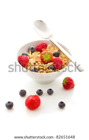 photo of delicious breakfast made of corn flakes with berries and fresh milk