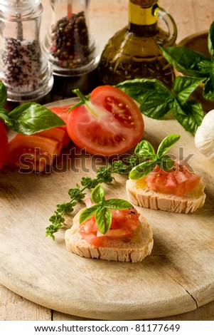 photo of delicious bruschetta with tomatoes on wooden table