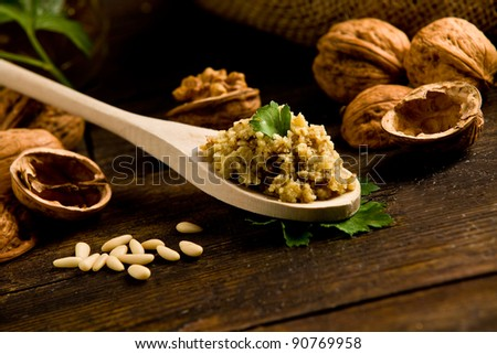 photo of delicious fresh ingredients for walnut pesto on wooden table