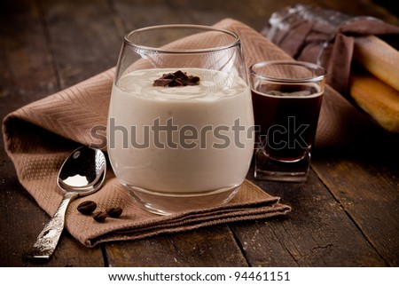 photo of delicious homemade and decomposed tiramisu on wooden table