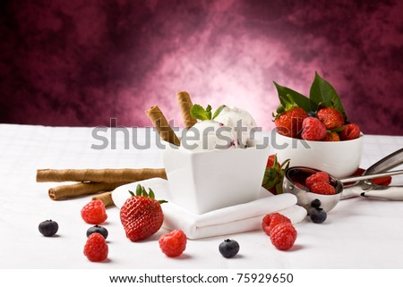photo of delicious ice cream with berries on the table