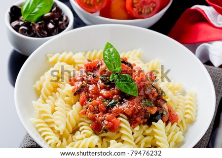 photo of delicious italian pasta with tomato sauce and basil