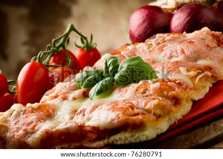 photo of delicious slice of pizza with basil leaf on it