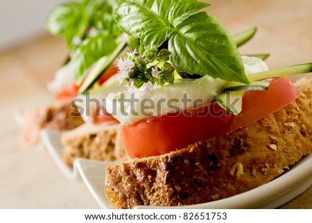 photo of delicious sliced cereal bread with tomato mozzarella