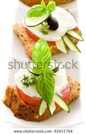 photo of delicious tomato mozzarella starter isolated white background