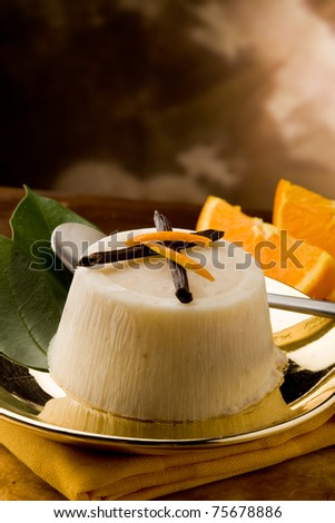 photo of delicious vanilla orange pudding on golden plate
