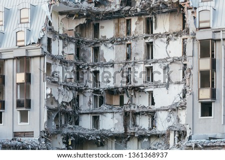 Photo of destroyed building, former hotel 5 stars/ demolition of a building, house ruins, rebirth, reconstruction, bricks and metal/ destruction of the walls, abandoned hotel, multi-storey building.