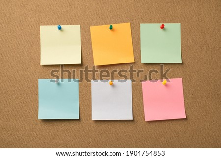 Photo of different colorful memo papers attached with pins to the wooden board Stock photo ©