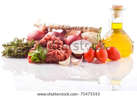 photo of different ingredients for preparing italian tomato sauce