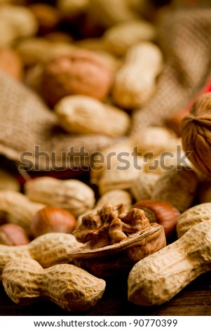 photo of different nuts inside a cloth on wooden table - stock photo