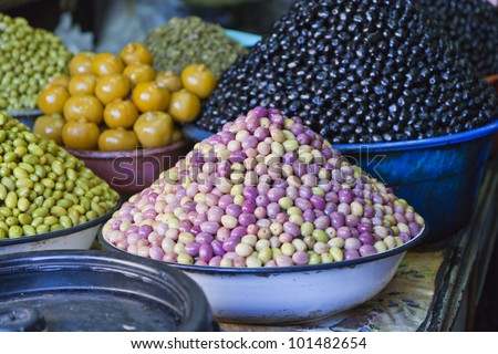 Photo of different types of olives being sold at Marrakesh market - stock photo