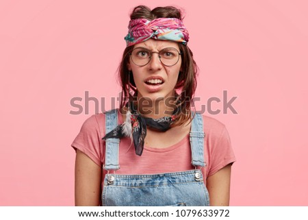 Photo of displeased hippie woman wears Indian clothes, has rogue lifestyle, extravagant appearance, rejects convential values, propagates independence from family and society. Youth subculture #1079633972