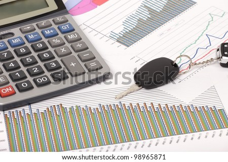 Photo of document some graphics with calculator and car key - stock photo