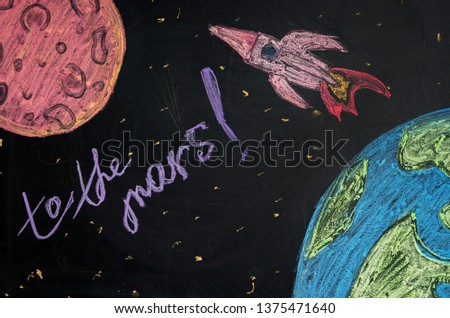 photo of drawing chalk on the board rocket flying from earth to the Mars, the journey to the Mars
