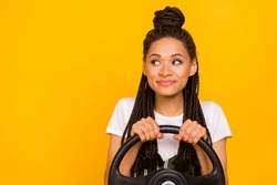 Photo of dreamy happy afro american young woman look empty space drive car isolated on yellow color background