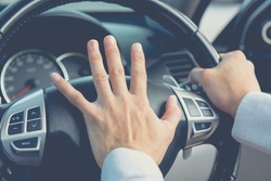 Photo of driver honking in traffic on the road