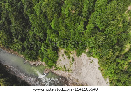 photo of dron: canyon with river and mountain slopes covered with forest, mountain river, rock Photo from above #1141105640