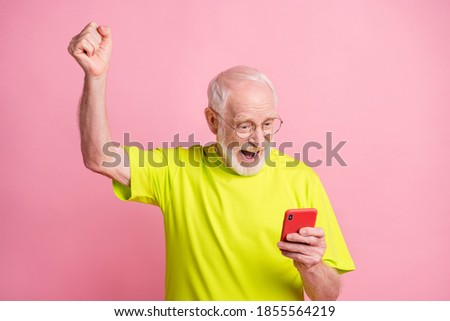 Photo of ecstatic person fist up open mouth triumph wear stylish lime t-shirt isolated on pink color background Foto stock ©