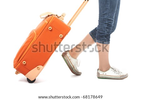 Photo of elegant female carrying red suitcase