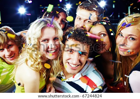 Photo of emotional teenagers laughing while having great party