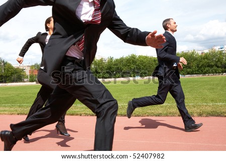 Photo of energetic business people in suits running