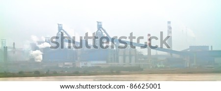 Photo of factories along Yellow River, the second longest river in China - stock photo