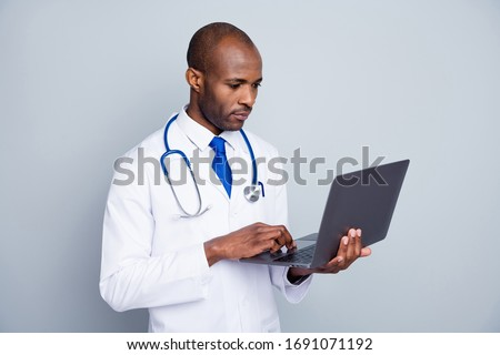 Photo of family doc dark skin guy hold notebook hands online consultation call video skype patients distance remote work wear lab coat tie stethoscope isolated grey color background