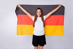Photo of fan lady raise big germany flag coat support country world soccer league cup pretty cheerleader wear football uniform t-shirt shorts isolated white color background