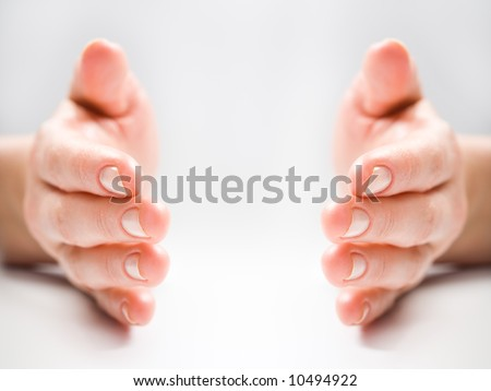 Photo of female fingers on a white background