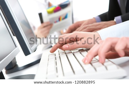 Photo of female hands pushing keys of keyboard