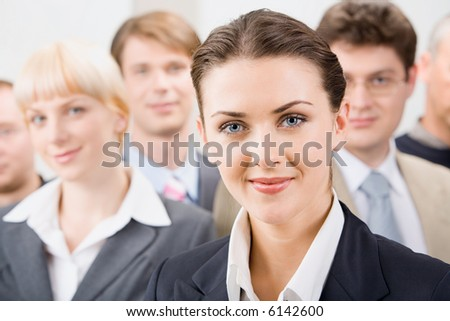 Photo of female leader with her business team