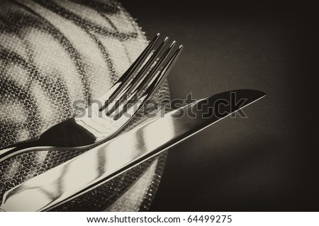 Photo of fork and knife on a plate