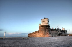 Photo of Fort Perch Rock and the Lighthouse at New Brighton, UK, at sunset