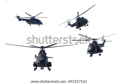 Photo of four military helicopters flying together while doing demonstrations, isolated on white background