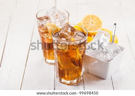 Photo of fresh lemon ice tea on white wooden table