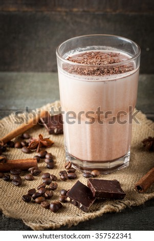 Photo of fresh Made Chocolate Banana Smoothie on a wooden table with coffee and spices. Selective focus. Milkshake. Protein diet. Healthy food concept. Drink, coffee beans, chocolate,  #357522341