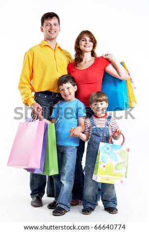 Photo of friendly parents and siblings with bags isolated over white background