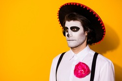 Photo of frightening ghost guy stare look empty space waiting dead men monster creatures marching wear white shirt death costume sugar skull suspenders isolated yellow color background