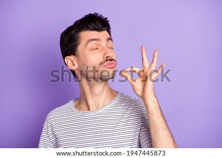 Photo of funky funny dreamy man with closed eyes trying delicious tasty food meal isolated on violet color background Foto stock ©