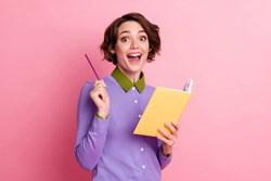 Photo of funny lady hold diary think over homework essay wear purple jumper isolated pink color background