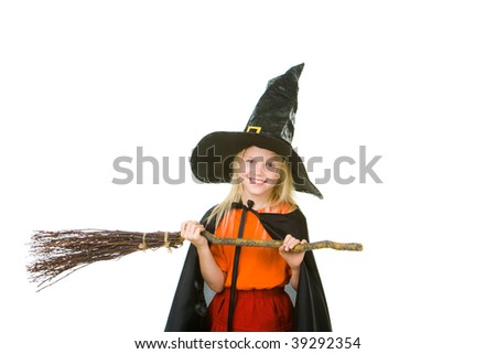 Photo of girl in halloween costume and broom isolated on white background