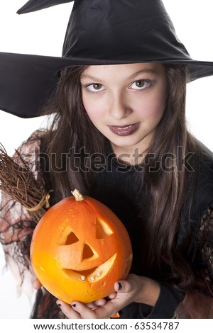 Photo of girl in halloween costume,  broom and pumpkin - stock photo
