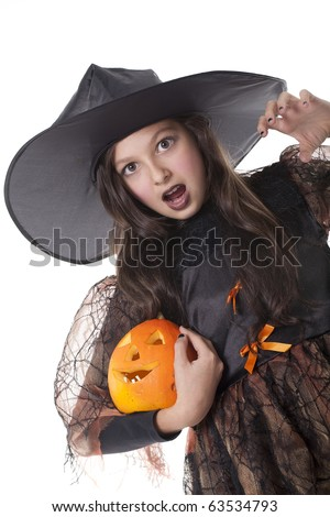 Photo of girl in halloween costume,  broom and pumpkin with scared face