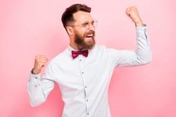 Photo of glad positive optimistic smart person feeling god raising fists up isolated pastel background