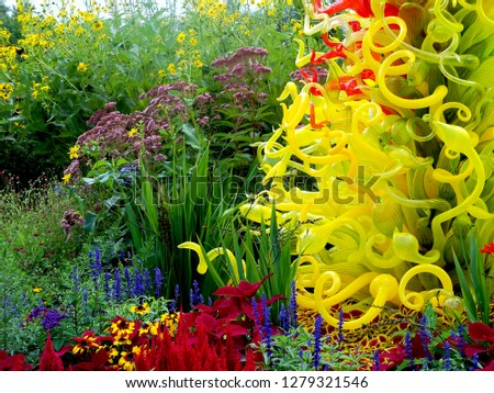 Photo of glass art among colorful flowers in Grand Rapids, Michigan